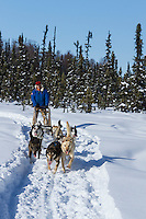 Dog musher Martin Buser runs his team during a spring training run on a lake  Southcentral, Alaska<br /> <br /> MR2013-03-23BuserMartin