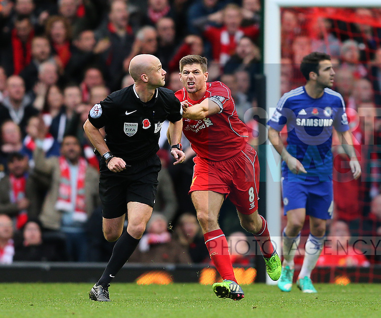 Steven Gerrard of Liverpool chases after referee Anthony Taylor claiming hand ball  by Gary Cahill of Chelsea  - Barclays Premier League - Liverpool vs Chelsea - Anfield Stadium - Liverpool - England - 8th November 2014  - Picture Simon Bellis/Sportimage