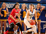 BROOKINGS, SD - DECEMBER 3: 	Macy Miller #12 from South Dakota State controls then ball away from Arica Carter #11 from Louisville during their game Sunday afternoon at Frost Arena in Brookings, SD.  (Photo by Dave Eggen/Inertia)
