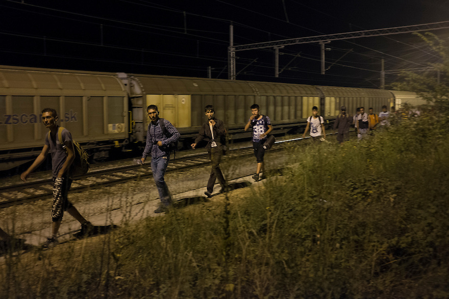 "Migrants arriving by train in Tabonovce, Macedonia, from the southern border town of Gevgelija, Macedonia-- in order to cross into Serbia. As many as 500 people crowd onto each train (there are three per day) in order to travel to the Serbian border, which is now permitted under Macedonian law. Since the new law was enacted in June, a huge increase in the numbers of people traveling the ""Western Balkan route"" to EU countries like Germany and Sweden, where they hope to receive asylum. PHOTO BY JODI HILTON"