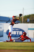 Batavia Muckdogs second baseman Mike Garzillo (11) jumps for a throw as Jesus Alastre (5) slides in during a game against the Williamsport Crosscutters on September 3, 2016 at Dwyer Stadium in Batavia, New York.  Williamsport defeated Batavia 10-0. (Mike Janes/Four Seam Images)