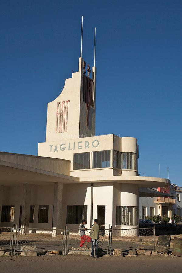 Construit en 1938, la station Fiat Tagilero en forme d avion est un des plus beaux monuments futuristes d asmara....Garage and service station Fiat Tagliero, one of Asmara's icons  built in 1938 by  Guiseppe Pettazzi