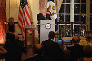 October 27, 2011  (Washington, DC)  Former Secretary of State Henry A. Kissinger speaks at the 50th Anniversary Celebration of the Diplomatic Rooms at the State Department in Washington.  Andrea Mitchell (left), NBC Chief Foreign Affairs Correspondent, looks on.  (Photo by Don Baxter/Media Images International)