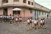 Schoolchildren in the southern town of Trinidad, which was declared a World Heritage site by UNESCO in 1988 to preserve the architectural legacy of its Spanish colonial history.