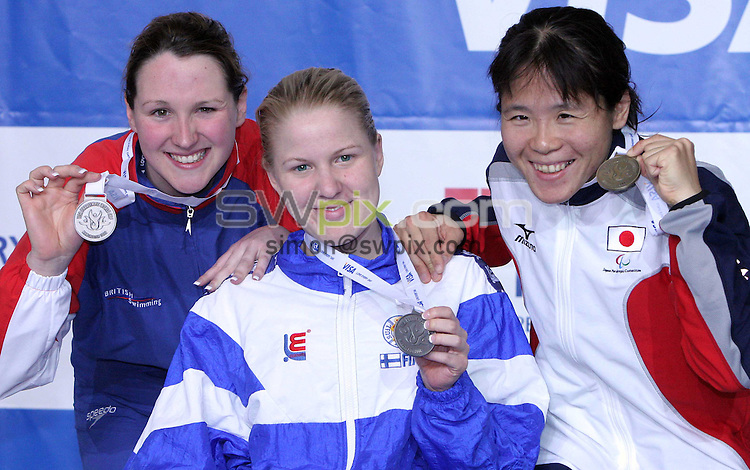 PICTURE BY VAUGHN RIDLEY/SWpix.com -  Swimming - Visa Paralympic World Cup - Manchester Aquatics Centre - Manchester, England - 06/05/06...? Simon Wilkinson - 07811 267706...Great Britain's Natalie Jones (L), Finland's Reeta Peltola (C) and Japan's Erika Nara (R) pose with their medals from the Women's S6 50m Freestyle Final.