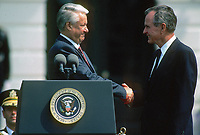***FILE PHOTO*** George H.W. Bush Has Passed Away<br /> Washington DC., USA, June 17, 1992<br /> President George H.W. Bush with Russian President Boris  Nikoloyevich Yeltsin at remarks on the South lawn of the White House after 2 days of meetings during a summit in Washington DC. <br /> CAP/MPI/MRN<br /> &copy;MRN/MPI/Capital Pictures