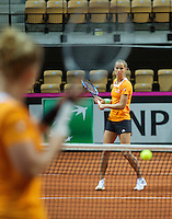 Arena Loire,  Trélazé,  France, 14 April, 2016, Semifinal FedCup, France-Netherlands, Dutch team warming up, Arantxa Rus <br /> Photo: Henk Koster/Tennisimages