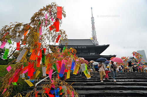 July 7th, 2012 : Tokyo, Japan -  Wishes were strung on bamboos as a custom of Tanabata Festival, a traditional festival on July 7 every year, at Zojoji, or Zojo Temple, at Shibakouen, Minato, Tokyo, Japan on July 7, 2012. Even though the festival was supposed to celebrate stars, it was raining and cloudy this year. (Photo by Koichiro Suzuki/AFLO)