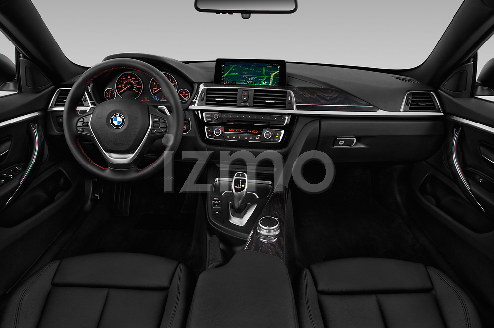 Stock photo of straight dashboard view of a 2018 BMW 4 Series Gran Coupe 430i 5 Door Hatchback