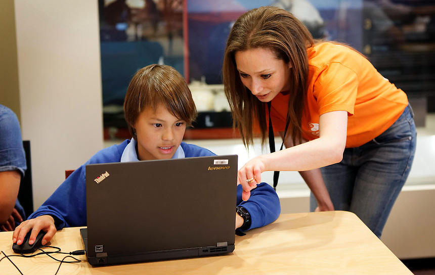 CoderDoJo, a volunteer led coding club for kids where they learn to code. One of the WA chapters is held at Woodsides' Perth HQ. Mechanical engineering graduate Kerryn Cappy mentors Luke Lummis (11). photo by Trevor Collens 8/12/2016