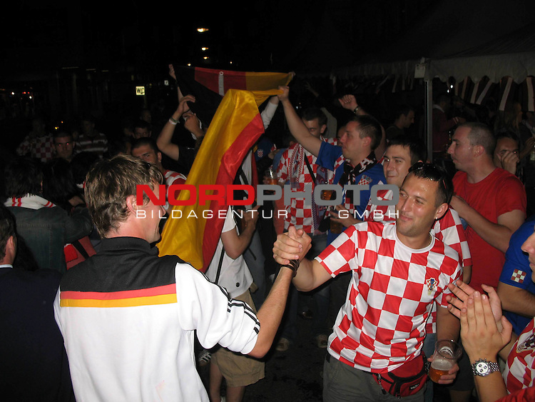 Supporters of Croatia and Germany together drinking in Klagenfurt, Austria. June 11, 2008 Photo by Sanjin Strukic/24sata /  nph (  nordphoto  )