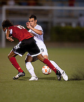 Peri Marsevic (9) defends Trent Lougheed (11). US Under 20 Men's National Team played to a scoreless draw vs Trinidad & Tobago, advancing after winning 4-3 on penalty kicks at the Marvin Lee Stadium in Macoya, Trinidad on March 13th, 2009 during the 2009 CONCACAF U-20 Championship.