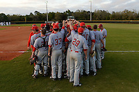 Ball State Cardinals team huddle after a game against the Dartmouth Big Green on March 7, 2015 at North Charlotte Regional Park in Port Charlotte, Florida.  Ball State defeated Dartmouth 7-4.  (Mike Janes/Four Seam Images)