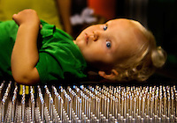"Visitors to Charlotte's Discovery Place museum check out Kid Science, an interactive hands-on learning lab created to inspire inquiry-based  learning. Here, a child tries out a ""bed of nails."" Discovery Place, Charlotte NC's interactive children's museum, unveiled its interactive exhibits and hands-on activities in June 2010. Renovations of the popular family museum were made possible by the City of Charlotte, the Arts and Science Council and private donations. Discovery Place museum has age-appropriate exhibits for kids of all ages."