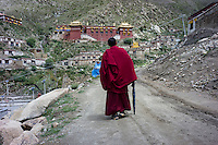 A Bon monk arrives at Menri Monastery, which is located 4,700 metres above sea level, in Namling county, Tibet, China, 2015. Menri is a leading Bon monastery in Tibet. The original Bon (Yungdrung Bon) was founded around 16,000 BC,  according to the followers who are called Bonpo. Today, Bon can be found in the more isolated parts of northern and western Tibet. According to the Chinese census, about 10% of Tibetans (about 100,000 people) follow Bon.