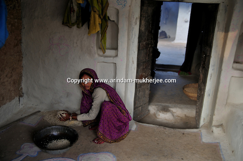 "Sita is a resident of Tarkhari village near Banda, her story is of violent land dispute between her husband and brother in law. The quarrel started with a wall - erected by her brother in law in their common land. As the quarrel grew bitterer, one night her brother in law's family along with her in laws broke into their house and attacked them. She and her husband were mercilessly beaten up following which she had a serious head injury. Land disputes being one of the commonest forms of quarrels in the agrarian societies of north India where land is one of the main sources of wealth, the local police station viewed it as a ""family matter"" and refused to take down an FIR. Owing to the political influence of her brother in law, the Gram Panchayat too remained unmoved. So, Sita and her husband ran from one official to another of the district and state level for justice. They being a dalit (the untouchables of India), hoped for some sympathy from Ms. Mayawati - the famed dalit Chief Minister of the state, but were apparently disappointed.  So, finally they decided to take a chance with Gulabi Gang. Upon hearing their plight Sampat Pal Devi, the leader of the disadvantaged women's association, went straight to their village, assembled the panchayat and the disputing families to bring about justice to the victims. The wall was demolished by Sita's family and Sampat pal Devi herself. Later on, Sampat Pal Devi had a discussion with the local police station about the necessities of taking down such serious complaints, not withstanding its nature of that of a family dispute. Now, Sita and her husband live separately without fear. They are no more in talking terms with the rest of the family. Uttar Padesh, India. Arindam Mukherjee"