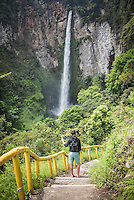 Photographer at 120m Sipisopiso Waterfall, Lake Toba (Danau Toba), North Sumatra, Indonesia