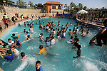 Palestinian children swim in a pool at an amusement park on the third day of Eid al-Fitr holiday which marks the end of the Muslim holy month of Ramadan, in Gaza City on June 27, 2017. Photo by Ashraf Amra