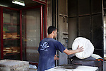 A Palestinian baker prepares bread at his bakery in Gaza city on February 21, 2013. Photo by Ashraf Amra