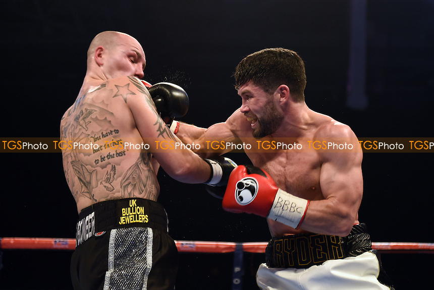 John Ryder (white shorts) defeats Adam Etches during a Boxing Show at Olympia on 4th February 2017