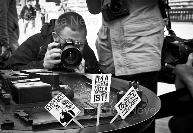 London, 03/05/2011. The NUJ's LPB - London Photographer (and Videographer) Branch - stage a flash mob outside London City Hall. The protest was organised because professional photographers are concerned about the growing number of incidents of private security guards stopping people taking photos in public places, claiming 'the prevention of terrorism'. These actions are seen to be promoted also by the police force. From the PHNAT website: <<I'm a Photographer, Not a Terrorist! (PHNAT), is the campaign group set up to fight unnecessary and draconian restrictions against individuals taking photographs in public spaces>>.