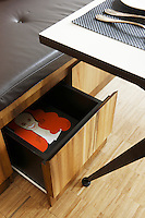 In the kitchen-diner there are drawers under the seat of the banquette for additional storage