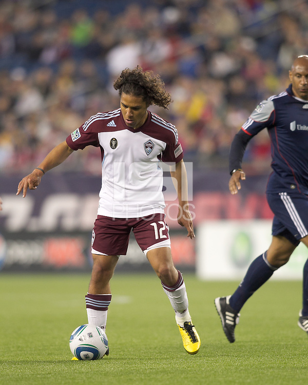 Colorado Rapids forward Quincy Amarikwa (12) dribbles. In a Major League Soccer (MLS) match, the New England Revolution tied the Colorado Rapids, 0-0, at Gillette Stadium on May 7, 2011.
