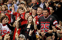 Texas Tech fans salute during the second half of the Valero Alamo Bowl, Saturday, Jan. 2, 2010, at the Alamodome in San Antonio. Texas Tech won 41-31. (Darren Abate/pressphotointl.com)