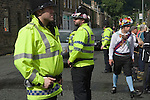 Greenfield Saddleworth Yorkshire UK. Police on crowd control. Saddleworth Rushcart weekend.