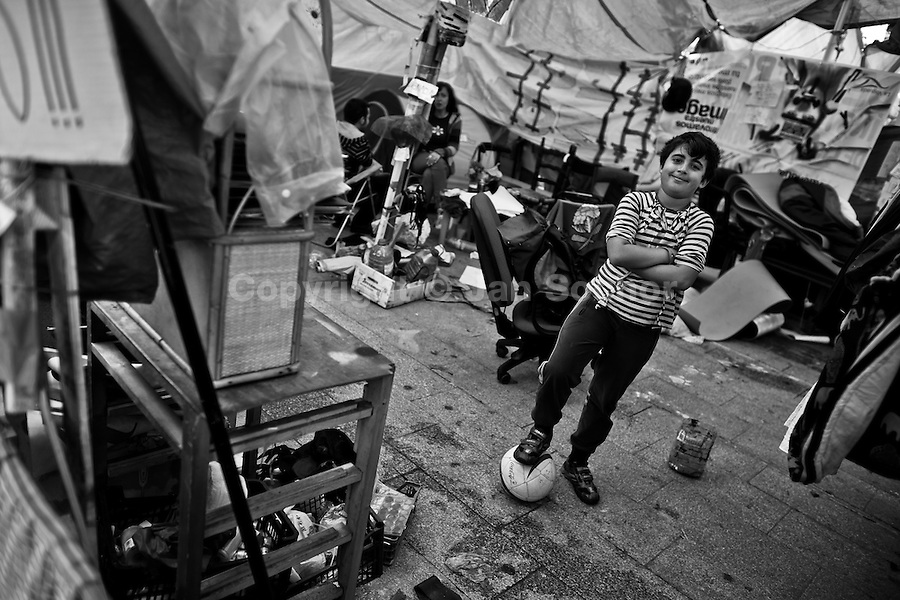A young Spanish protester poses with a ball under a tent in the protest camp on Puerta del Sol square, Madrid, Spain, 7 June 2011.