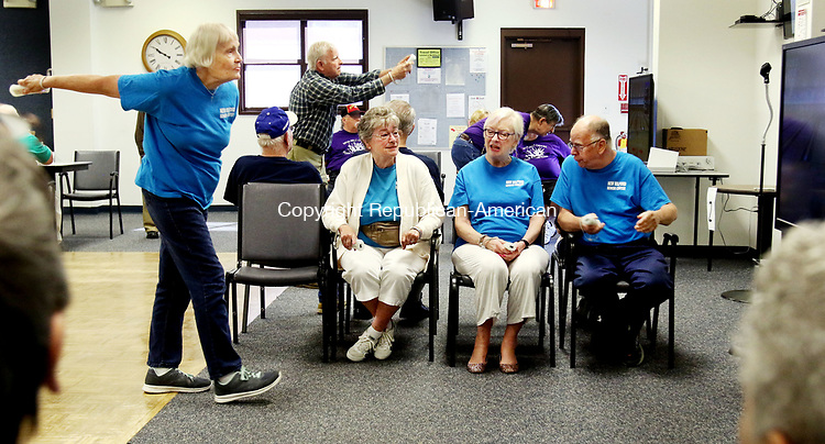 TORRINGTON CT. 26 July 2017-072617SV06-From left, Lorna MacInnis bowls while her teammates Judy Villani, Maryl Lewis, and Richard Sherwood all of New Milford watching during the annual Wii Bowling Invitation at the Sullivan Senior Center in Torrington Wednesday. <br /> Steven Valenti Republican-American