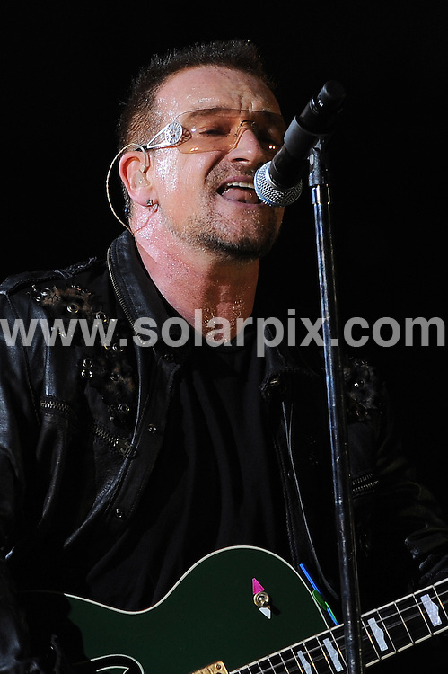 **ALL ROUND PICTURES FROM SOLARPIX.COM**.**WORLDWIDE SYNDICATION RIGHTS EXCLUDING ITALY - NO PUBLICATION IN ITALY**.U2 live in San Siro stadium, Milan, Italy. 7 July 2009..This pic: Bono..JOB REF: 9442  MXN       DATE: 07_07_2009.**MUST CREDIT SOLARPIX.COM OR DOUBLE FEE WILL BE CHARGED**.**ONLINE USAGE FEE GBP 50.00 PER PICTURE - NOTIFICATION OF USAGE TO PHOTO @ SOLARPIX.COM**.**CALL SOLARPIX : +34 952 811 768 or LOW RATE FROM UK 0844 617 7637**