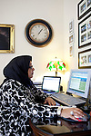 For a Brian Knowlton FF story on Muslim women in the US..USA, Peachtree City, GA. 11, NOVEMBER, 2010. Soumaya Khalifa, who created the Islamic Speakers Bureau based in Atlanta, Georgia sits at her desk in her home office in Peachtree City, Georgia... //// KENDRICK BRINSON/LUCEO for the International Herald Tribune