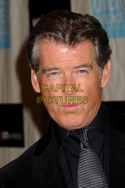 PIERCE BROSNAN .Attending the 38th Annual Peace Over Violence Humanitarian Awards held at The Beverly Hills Hotel, Beverly Hills, California, USA, 6th November 2009..portrait headshot black velvet tie shirt mouth funny .CAP/ADM/BP.©Byron Purvis/AdMedia/Capital Pictures.