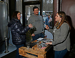 Oxford CT-011919MK01 Jennifer and Kevin Mardorf are greeted by event coordinator Marissa Leone at Black Hog Brewing Co. in Oxford. The event featured 26 breweries from all over New England along with artisan snack vendors and food trucks.  Leone said that they hoped to raise over $3000 to benefit The Connecticut Children's Medical Center. Michael Kabelka / Republican American
