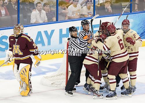 Kent Patterson (Minnesota - 35), Glenn Cooke, Barry Almeida (BC - 9), Bill Arnold (BC - 24), Steven Whitney (BC - 21), Patrick Wey (BC - 6), Brian Dumoulin (BC - 2) - The Boston College Eagles defeated the University of Minnesota Golden Gophers 6-1 in their 2012 Frozen Four semi-final on Thursday, April 5, 2012, at the Tampa Bay Times Forum in Tampa, Florida.