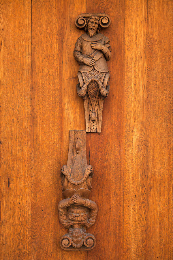 Wood carving of a male and female on a front door in Prague, Mala Strana, Czech Republic, Europe