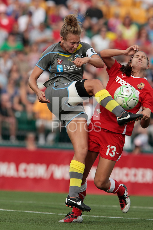Nikki Krzysik (15) of the Philadelphia Independence, left, defends against Alex Morgan (13) of the Western New York Flash. The Western New York Flash defeated the Philadelphia Independence 5-4 on penalty kicks after overtime following a 1-1 tie in the Women's Professional Soccer (WPS) Championship game at Sahlen's Stadium in Rochester, NY August 27, 2011.