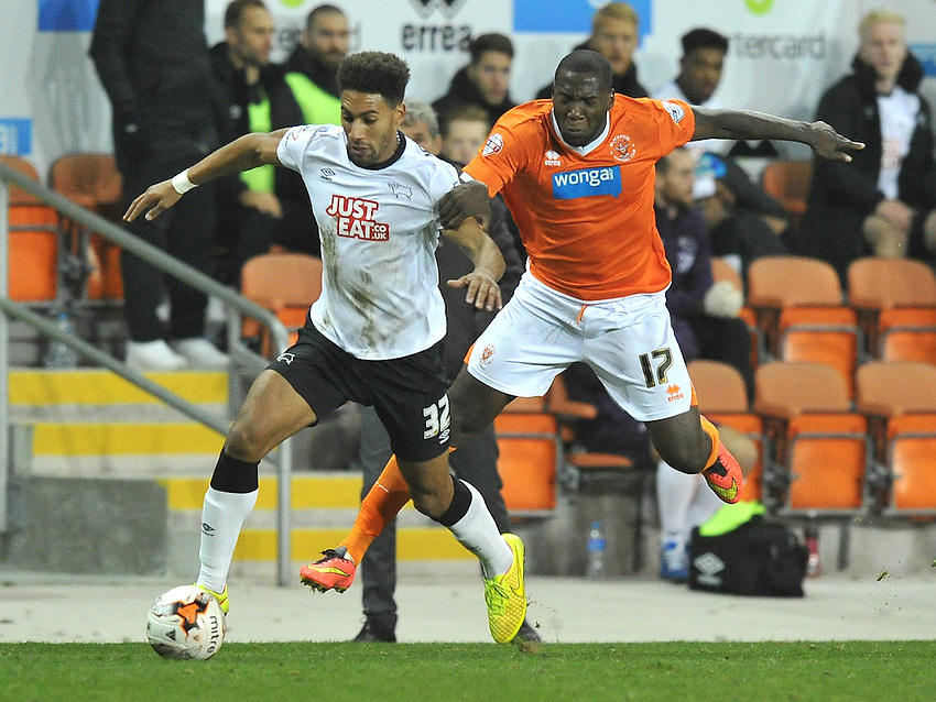 Blackpool's Ishmael Miller battles with  Derby County's Ryan Shotton<br /> <br /> Photographer Dave Howarth/CameraSport<br /> <br /> Football - The Football League Sky Bet Championship - Blackpool v Derby County - Tuesday 21st October 2014 - Bloomfield Road - Blackpool<br /> <br /> &copy; CameraSport - 43 Linden Ave. Countesthorpe. Leicester. England. LE8 5PG - Tel: +44 (0) 116 277 4147 - admin@camerasport.com - www.camerasport.com