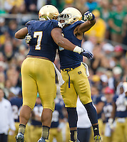 Stephon Tuitt (7) celebrates with linebacker Jaylon Smith (9) after his sack.