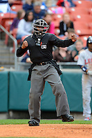 Umpire A.J. Johnson makes a call during the first game of a double header between the Buffalo Bisons and Lehigh Valley IronPigs on June 7, 2013 at Coca-Cola Field in Buffalo, New York.  Buffalo defeated Lehigh Valley 4-3.  (Mike Janes/Four Seam Images)