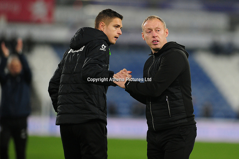 Kristoffer Peterson of Swansea City shakes hands with Steve Cooper Head Coach of Swansea City during the Sky Bet Championship match between Huddersfield Town and Swansea City at The John Smith's Stadium in Huddersfield, England, UK. Tuesday 26 November 2019