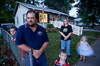 Layed-off welder Chuck Salak  with sons Cody, 10, Riley, 4, and Lacey, 4, and wife Lisa in Columbus, Nebr. The agricultural and manufacturing town has suffered in the weak economy, resulting in many local layoffs.  (Kevin Moloney for the New York Times)