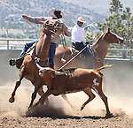 Joel Kruger and Nick Uhart compete in the branding event at the Minden Ranch Rodeo on Sunday, July 24, 2011, in Gardnerville, Nev. The annual event benefits the Douglas High Rodeo scholarship fund..Photo by Cathleen Allison