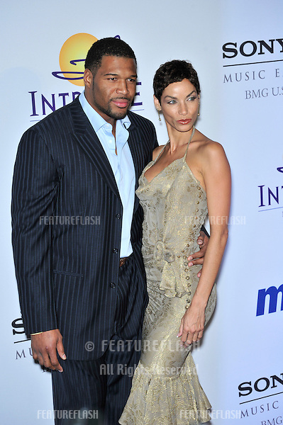 Nicole Murphy & NFL star Michael Strahan  at music mogul Clive Davis' annual pre-Grammy party at the Beverly Hilton Hotel..February 9, 2008  Los Angeles, CA.Picture: Paul Smith / Featureflash