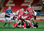 Scarlets scrum half Gareth Davies kicks from the back of the breakdown.<br /> Celtic League<br /> Scarlets v Munster<br /> <br /> 01.03.14<br /> <br /> &copy;Steve Pope-SPORTINGWALES
