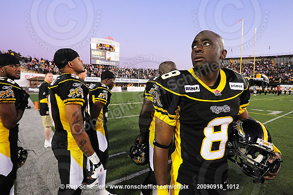 September 18, 2009; Hamilton, ON, CAN; Hamilton Tiger-Cats wide receiver Corey Grant (8) looks up in the stands during the singing of the national anthem. CFL football: Calgary Stampeders vs. Hamilton Tiger-Cats at Ivor Wynne Stadium. The Tiger-Cats defeated the Stampeders 24-17. Mandatory Credit: Ron Scheffler. Copyright (c) 2009 Ron Scheffler.