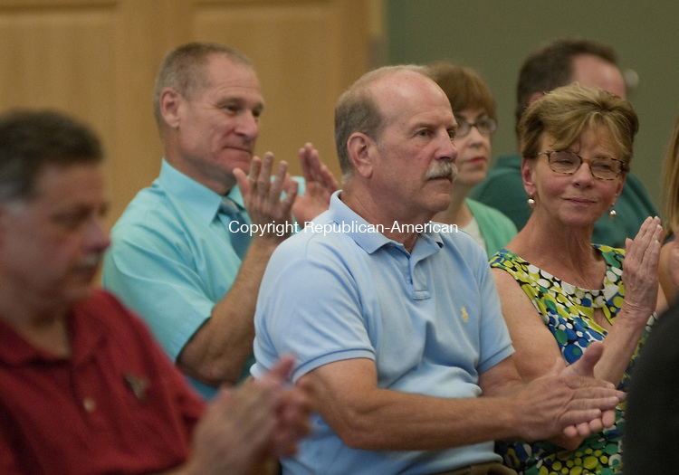 TORRINGTON, CT, 28  JULY 15 - Daniel T. Farley, center, applauds as the Republican slate for City Council, is approved at the Republican Town Committee's nominating caucus Tuesday in Torrington. Farley is seeking a seat on the council. Alec Johnson/ Republican-American