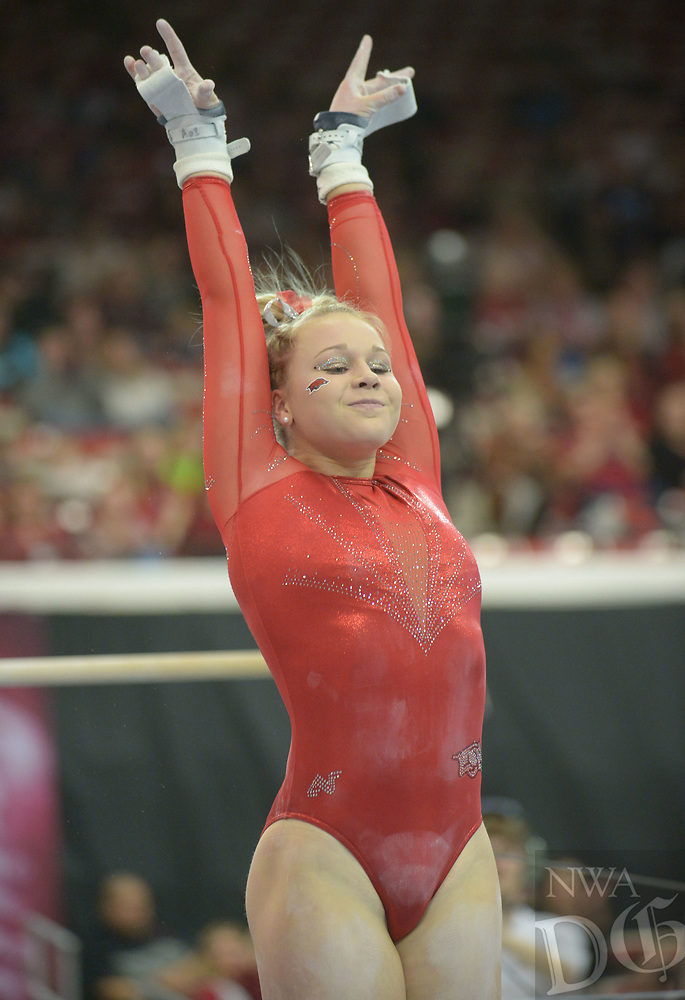 NWA Democrat-Gazette/ANDY SHUPE<br /> Arkansas' Sydney Laird competes in the bars Saturday, Jan. 5, 2019, during the Razorbacks' meet with No. 2 Oklahoma in Barnhill Arena in Fayetteville. Visit nwadg.com/photos to see more photographs from the meet.