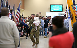 Carrying his niece Scarlet Harrison, Chief Warrant Officer II Josh Groth and fellow Nevada Army Guard soldiers walk through the Reno-Tahoe International Airport in Reno, Nev., on Sunday, Feb. 16, 2014. About 300 supporters greeted the 1/168th General Support Battalion after a 10-month deployment in Afghanistan. (Las Vegas Review-Journal/Cathleen Allison)